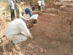 Peter working with the other volunteers to prepare the bricks for moving