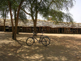 Main school building with thatched roof