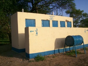 The toilet block with a hand washing tank out the front.